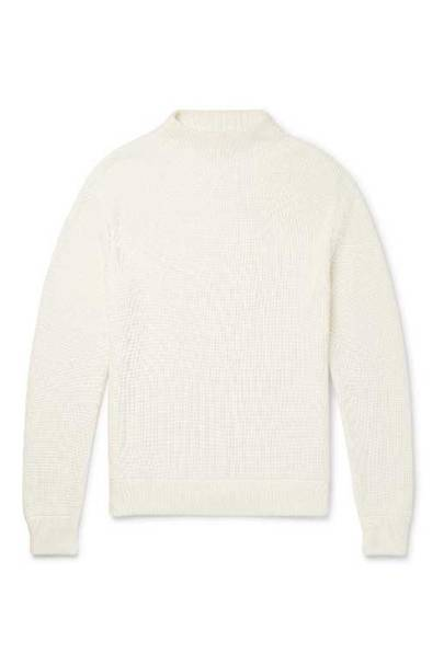 Mock necks have gotten a bad name in recent years, but this smart ivory-hued sweater from Mr P's second drop is just the thing for these last days of winter.
