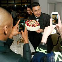 Hu Bing celebrates his birthday at GQ's LCM closing night dinner