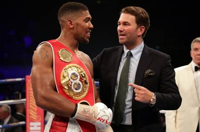 Number one: Anthony Joshua celebrates with Eddie Hearn after beating Dominic Breazeale at the O2 in London