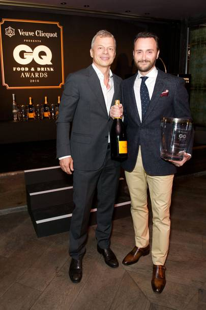 Rainer Becker presents best restaurateur winner, Jason Atherton