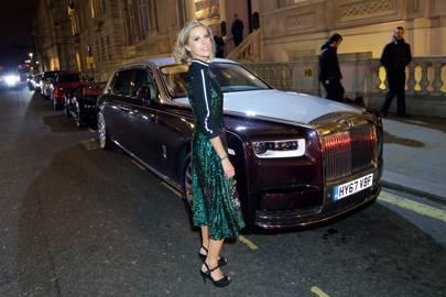 Nikki Shields in front of the Rolls-Royce Phantom