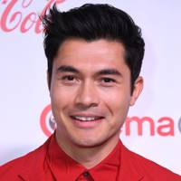 Henry Golding's hair is winking at us