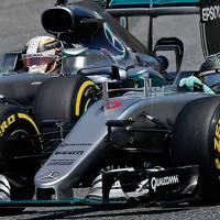 Lewis Hamilton and Nico Rosberg make contact at the Barcelona Grand Prix