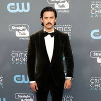 Milo Ventimiglia in Ralph Lauren with Christian Louboutin shoes, a David Yurman ring, Rolex watch, and Montblanc cuff links