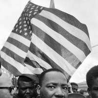Martin Luther King with Flag, Selma March 1965