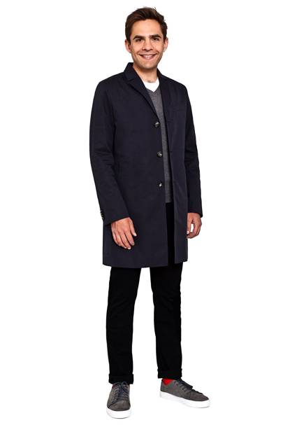 Coat by J Lindeberg, £350. T-shirt by J Lindeberg, £50. Jumper by Sand Copenhagen, £130. Jeans by Paige, £205. Shoes by Garment Project, £120. Socks by The London Sock Company, £12.