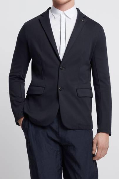 14. A navy blue deconstructed jacket