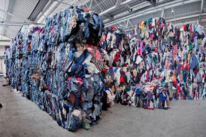 Mountains of sorted clothing at the I:CO plant in Wolfen, Germany