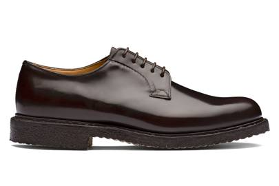 21. A pair of chestnut brown lace-ups