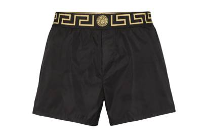 Greca border swim shorts by Versace
