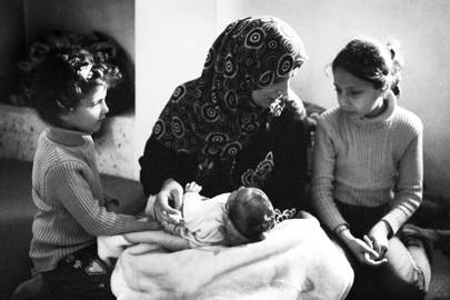 Malak Alazam with her three daughters. In 2014, while the family relaxed on their rooftop in Syria, a rocket hit their house. Two of her daughters were killed, another lost an eye and Malak herself lost her leg – Ajloun, Jordan. April 2016