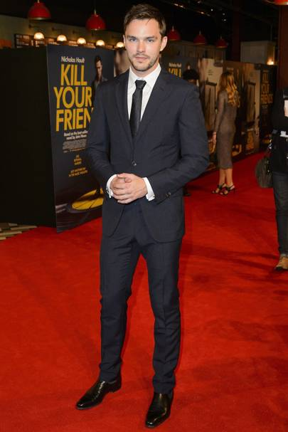 Nicholas Hoult shows you why a black suit will never go out of