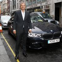 Rainer Becker arrives in the luxury BMW 7 Series
