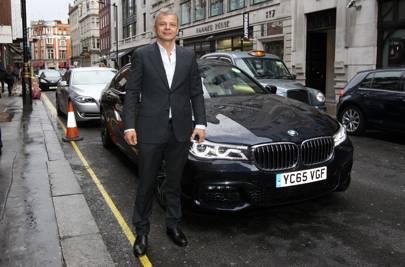 Rainer Becker arrives in the luxury BMW 7 Series