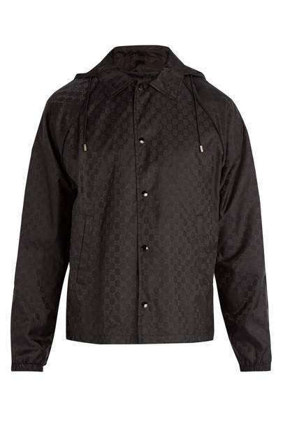 Logo-print hooded windbreaker jacket by Gucci