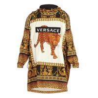 Leopard-print hooded raincoat by Versace