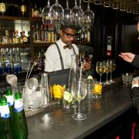 Mixologists getting the Ciroc Vodka cocktails ready and opening the Peroni beers