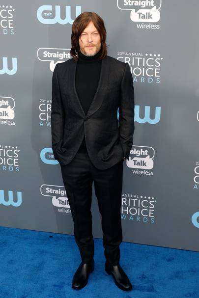 Norman Reedus in Ermenegildo Zegna Couture with Christian Louboutin shoes and a Rolex watch